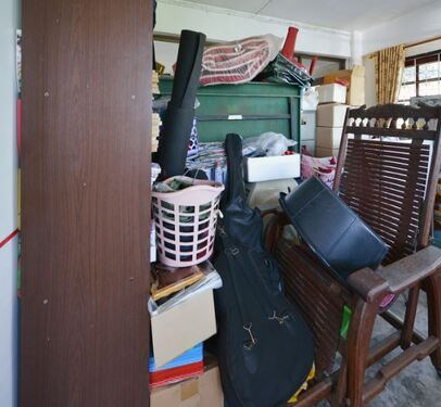 Hoarder home full of junk furniture and random junk objects
